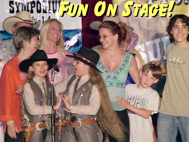 Cassandra & Calena of The Sunset Pioneers on stage with the cast of the Little House on the Prairie TV show