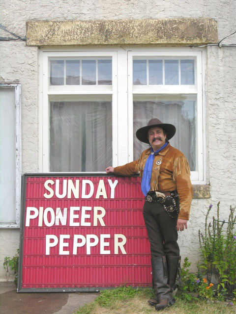 Pioneer Pepper with a sign  Dusty Cartride on cowboy poetry